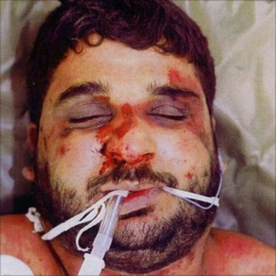 The murdered Baha Mousa, an innocent Basra civilian. Hooded, manacled, denied food and water. Ninety-three injuries. Beaten by British soldiers in 2003. Was subject to several practices banned under British law and the Geneva Convention. Legal case against government continually thwarted by authorities. One soldier eventually sentenced to one year in military custody